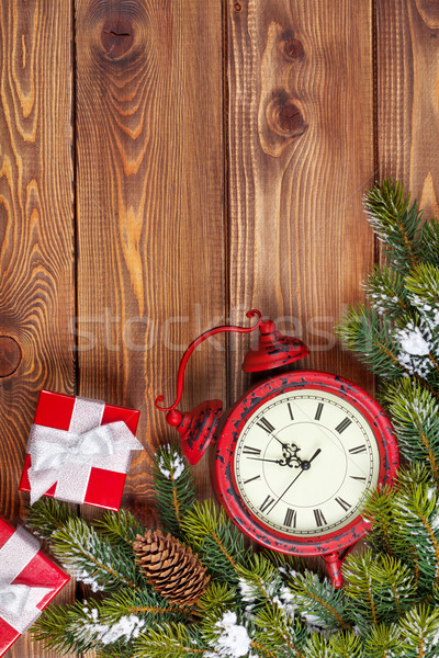 Christmas wooden background with clock, fir tree and gift boxes Stock photo © karandaev