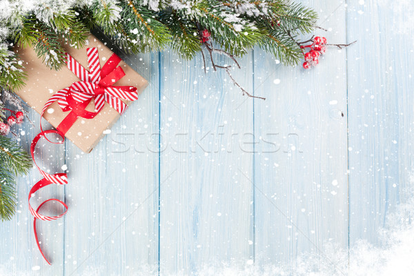 Christmas background with fir tree and gift box Stock photo © karandaev