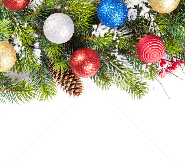 Stock photo: Christmas tree branch with snow and baubles