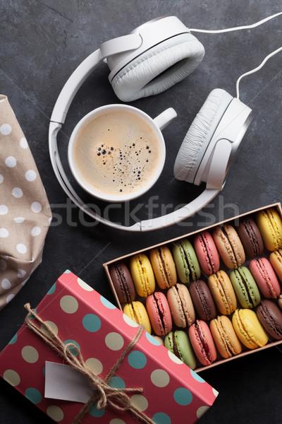 Colorful macaroons in a box and headphones Stock photo © karandaev