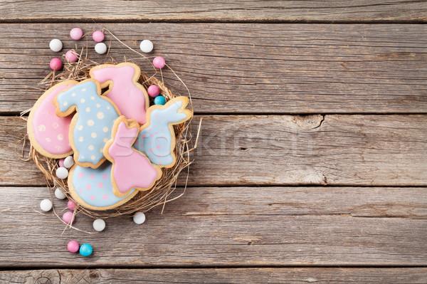 Húsvét mézeskalács sütik fa asztal nyulak tojások Stock fotó © karandaev