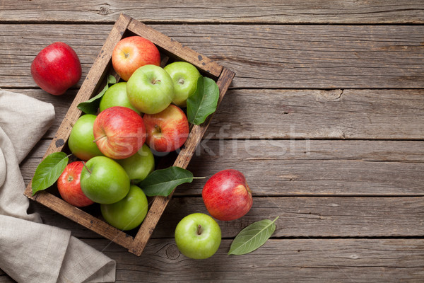 Green and red apples in wooden box Stock photo © karandaev