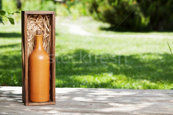 Wine bottle in wooden box Stock photo © karandaev