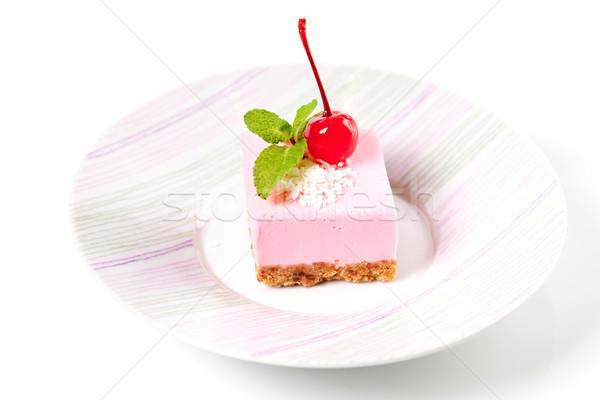 Pink cheesecake with maraschino cherry and mint Stock photo © karandaev