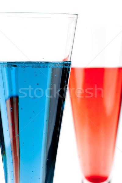 Red and Blue Champagne alcohol cocktail Stock photo © karandaev