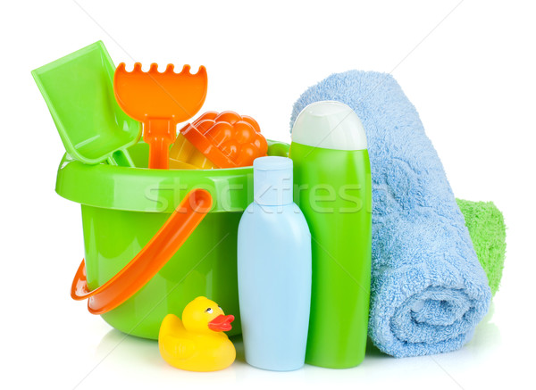 Beach baby toys, towels and bottles Stock photo © karandaev
