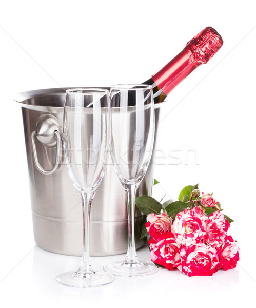 Champagne bottle, two glasses and red rose flowers Stock photo © karandaev