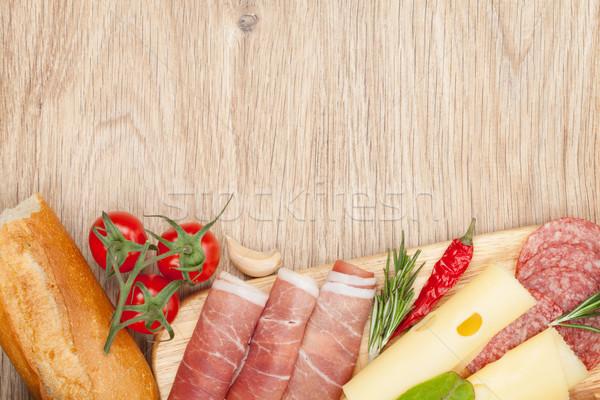 Sajt prosciutto kenyér zöldségek fűszer fa asztal Stock fotó © karandaev