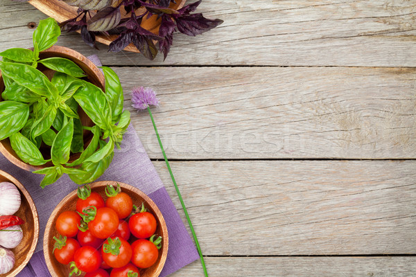 Fresh farmers tomatoes and basil on wood table Stock photo © karandaev
