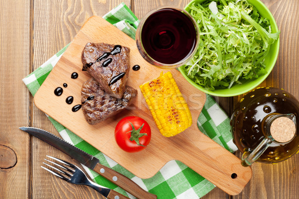 Steak with grilled corn, salad and red wine Stock photo © karandaev