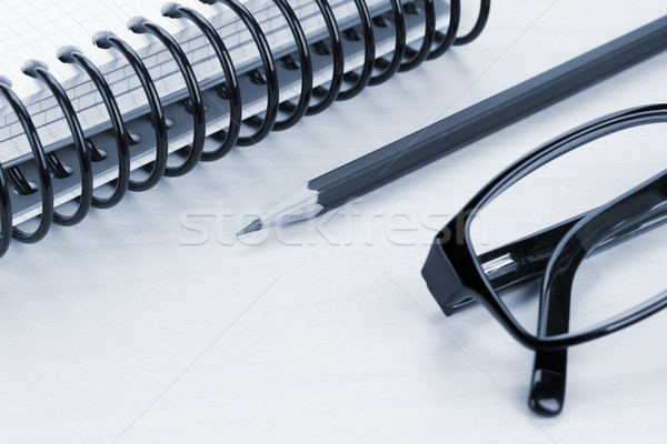 Office table with glasses, notepad and supplies Stock photo © karandaev