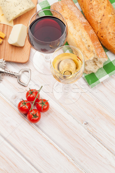 Stock photo: White and red wine, cheese and bread on white wooden table backg