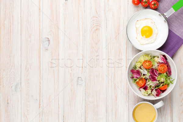 Healthy breakfast with fried egg, tomatoes and salad Stock photo © karandaev