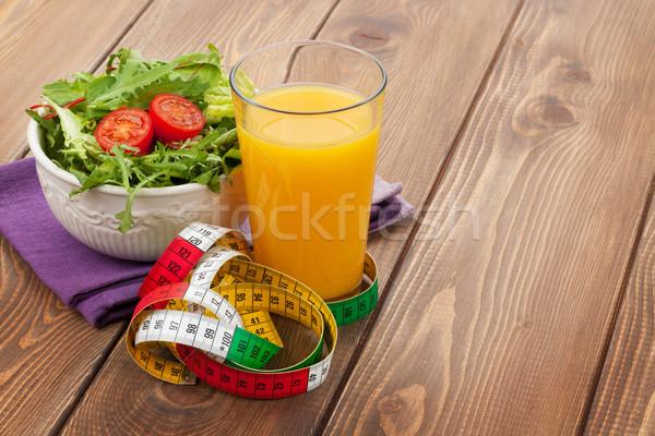 Egészséges étel mérőszalag fa asztal fitnessz egészség étel Stock fotó © karandaev