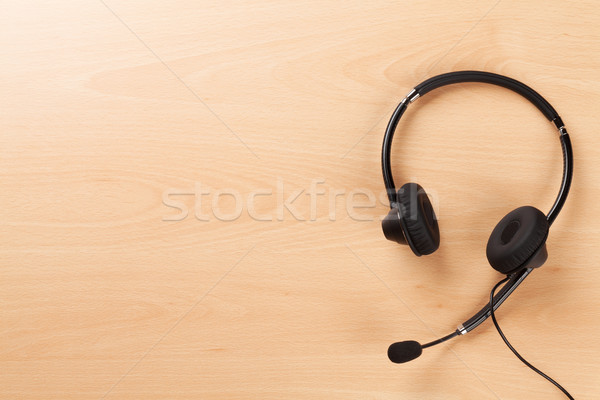 Office desk with headset. Call center support table Stock photo © karandaev
