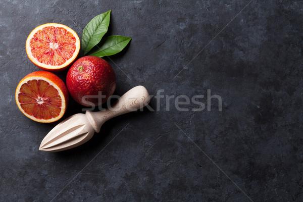 Red oranges and juicer Stock photo © karandaev