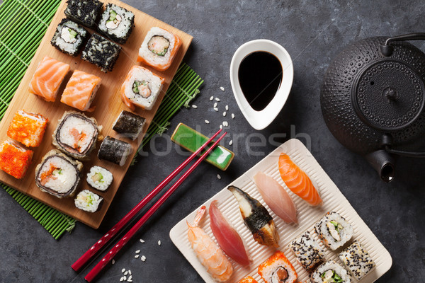 Set of sushi and maki roll and green tea Stock photo © karandaev