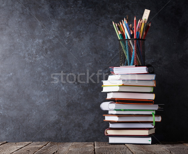 Books and supplies in front of chalk board Stock photo © karandaev