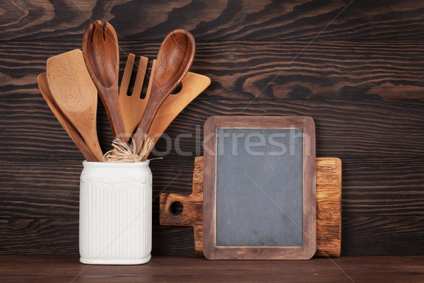 Kitchen utensils and chalkboard Stock photo © karandaev