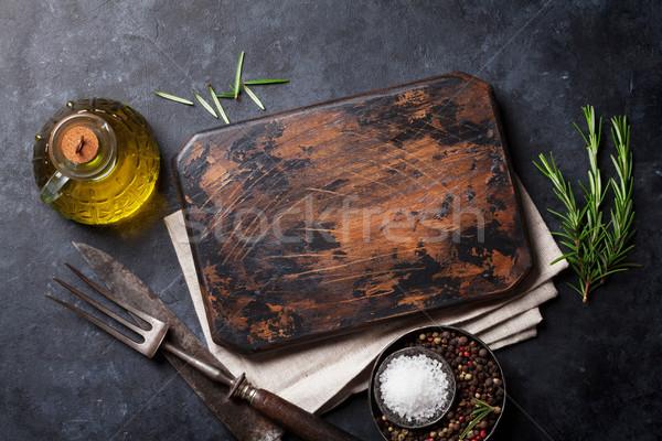 Cooking ingredients and utensils on stone table Stock photo © karandaev