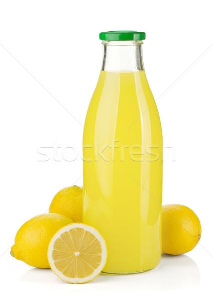 Zdjęcia stock: Butelki · cytryny · soku · świeże · cytryny · odizolowany