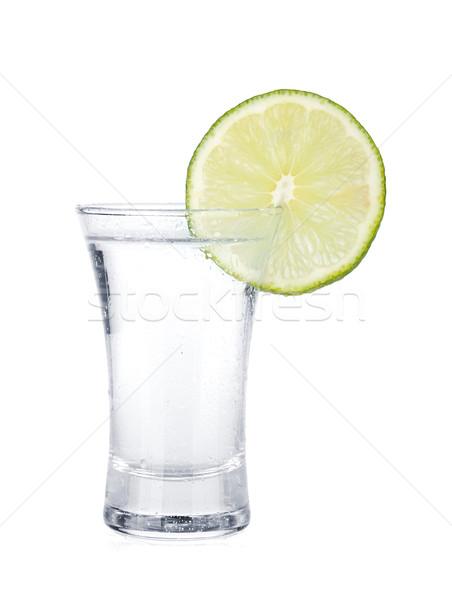 Coup vodka chaux tranche isolé blanche Photo stock © karandaev