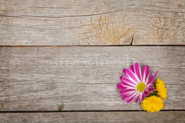 Flowers on wooden table Stock photo © karandaev