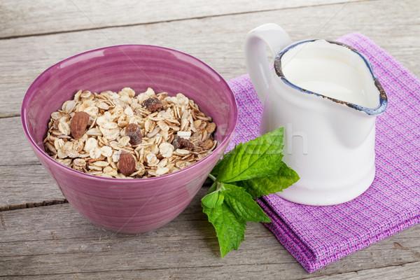 Healty breakfast with muesli and milk Stock photo © karandaev