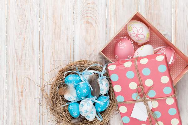 Easter with blue and white eggs in nest and gift box Stock photo © karandaev