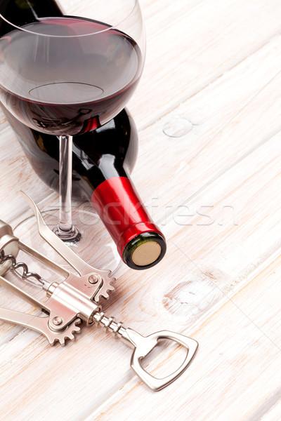 赤ワイン ボトル ガラス コークスクリュー 白 木製のテーブル ストックフォト © karandaev