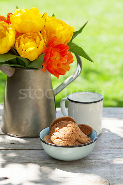 Colorful tulips bouquet, cookies and milk Stock photo © karandaev