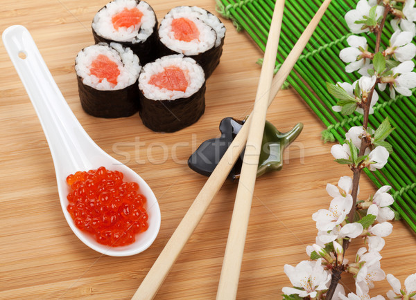 Red caviar, sushi set, sakura branch and chopsticks Stock photo © karandaev