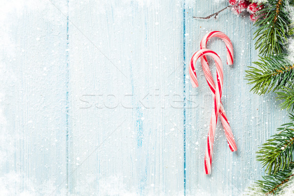 Stock photo: Candy cane and christmas tree on wooden table