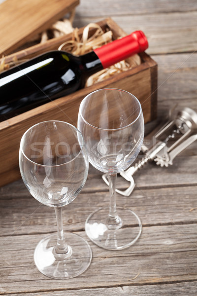 Stock photo: Red wine bottle and glasses