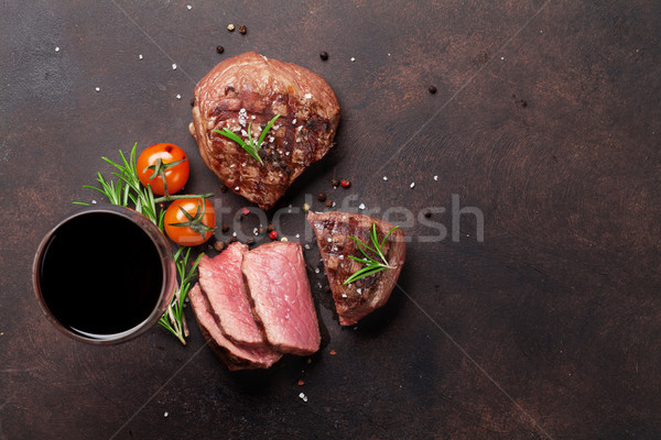 Grilled fillet steaks and glass of red wine Stock photo © karandaev