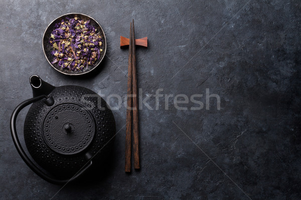Teapot, dry tea and sushi chopsticks Stock photo © karandaev