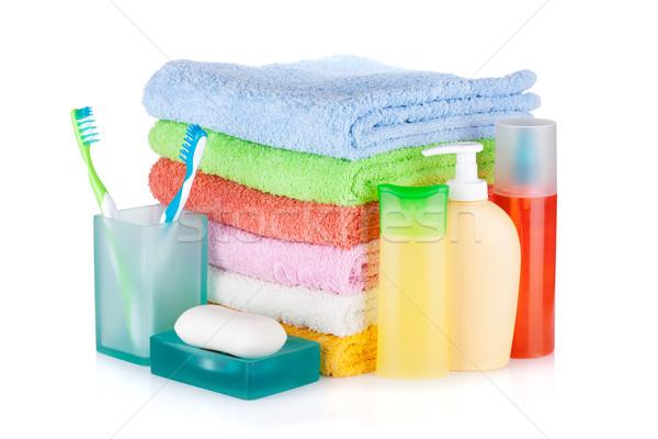 Foto stock: Dois · colorido · cosméticos · garrafas · sabão · toalhas
