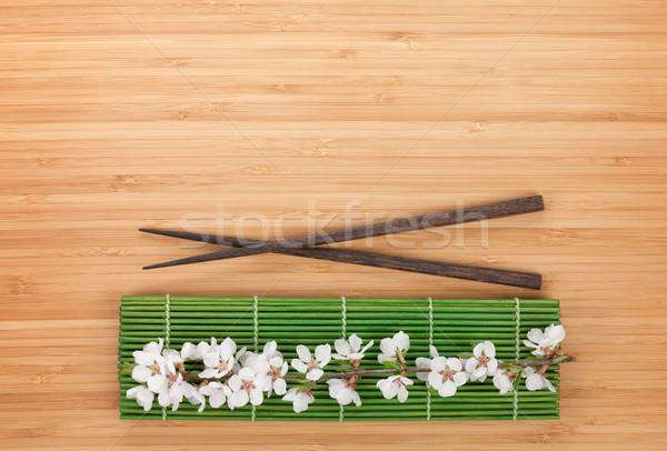 Baguettes sakura branche bambou table espace de copie Photo stock © karandaev