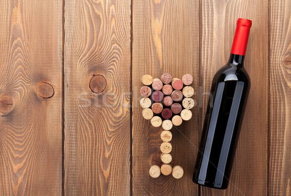 Vin rouge bouteille verre rustique table en bois Photo stock © karandaev