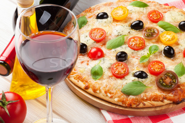 Italian pizza and red wine Stock photo © karandaev