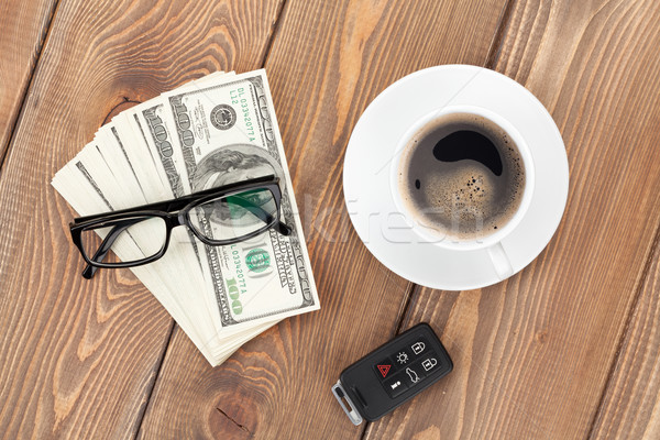 Money cash, glasses, car remote and coffee cup Stock photo © karandaev