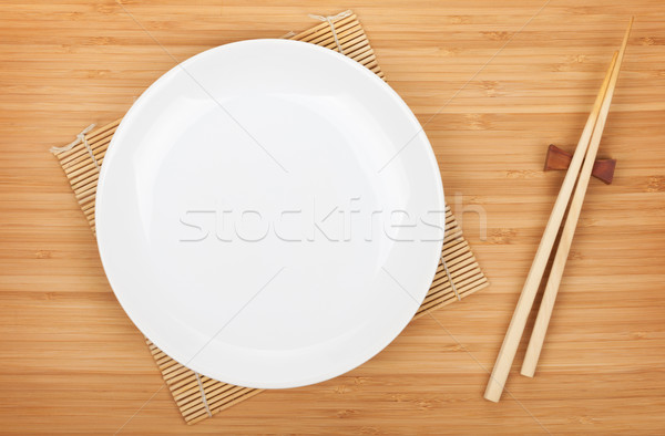 Empty plate and sushi chopsticks Stock photo © karandaev