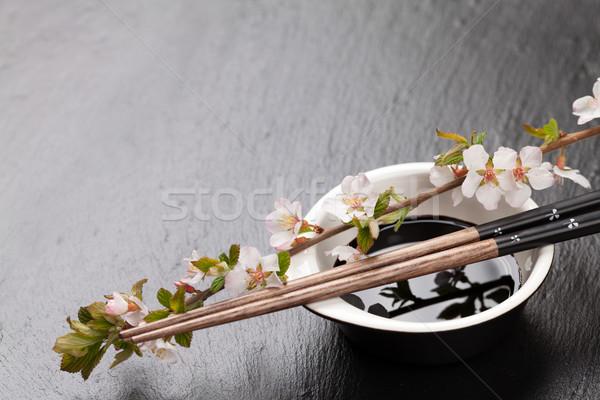 Japonês sushi molho de soja tigela sakura Foto stock © karandaev