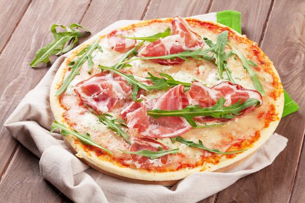 Pizza prosciutto mesa de madeira queijo jantar Foto stock © karandaev