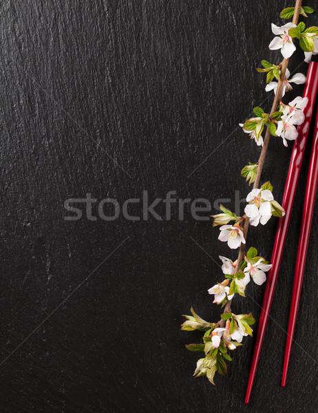 Japon sushi Çin yemek çubukları sakura çiçek siyah Stok fotoğraf © karandaev
