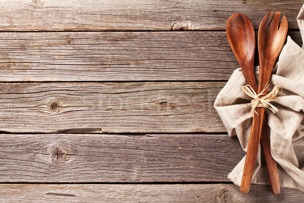 Kitchen utensil over wooden table background Stock photo © karandaev
