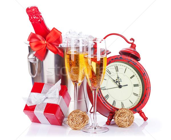 Two champagne glasses, bottle in cooler and clock Stock photo © karandaev