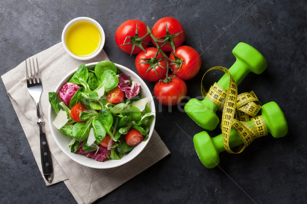 Healthy salad and fitness equipment Stock photo © karandaev