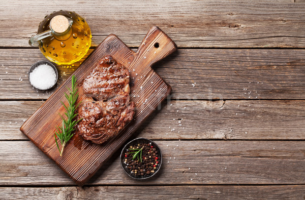 Grilled beef steak with spices on cutting board Stock photo © karandaev