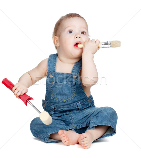 Small baby worker with paint brush and roller Stock photo © karandaev